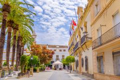 Ayamonte, Andalucia, Spain. A view along the side of Plaza de la Laguna with the town hall on the right, looking at Parroquia de las Angustias church in Ayamonte Stock Photo