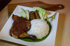 Ayan Penyet. Ayam penyet is Indonesian — more precisely East Javanese cuisine — fried chicken dish consisting of fried chicken that is smashed with the Royalty Free Stock Images