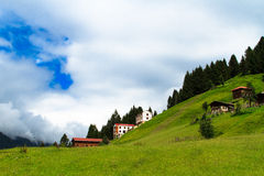 Ayder Plateau. Mountain houses with beautiful sky in Ayder Plateau, Rize, Turkey Royalty Free Stock Image