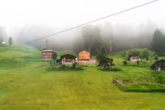 Ayder Plateau. Old wooden traditional houses with green in Ayder Plateau, Rize, Turkey Royalty Free Stock Photo