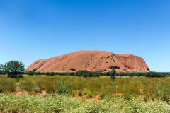 Ayers Rock. The great Ayers Rock (Uluru) in Yulura. You can see how green can it be if there are some rainy days Stock Photos