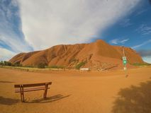 AYERS ROCK WITH THE BENCH royalty free stock image