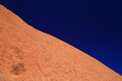 Ayers rock in contrast with blue sky Stock Image
