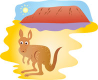 Ayers Rock and kangaroo. A cartoon illustration of a kangaroo in front of Ayers Rock or Uluru in Australia Royalty Free Stock Image