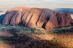 Ayers Rock (Uluru) from heli Stock Photo