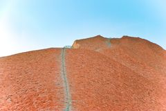 Ayers Rock, Tourist Attraction, steep climbing way up to summit, Australia, aerial view, seen from Heli Royalty Free Stock Image