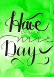 Ayez un lettrage tiré par la main de beau jour avec le fond de vert d'aquarelle Image stock