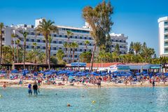 AYIA NAPA, CYPRUS - APRIL 04, 2016: People on the Nissi beach Stock Images