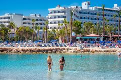 AYIA NAPA, CYPRUS - APRIL 04, 2016: People relaxing and sunbathi Royalty Free Stock Photography