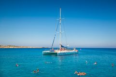 AYIA NAPA, CYPRUS - JULY 16, 2016: Catamaran loaded with tourist Stock Images