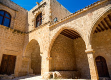 Ayia Napa monastery, gates connected to the rampart, surrounding Stock Photography