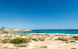 Ayia Napa. View along the beautiful cost of Ayia Napa looking toward Cape Greco in the very far distance Stock Photos