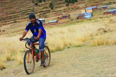 Aymara man riding the bicycle Royalty Free Stock Images