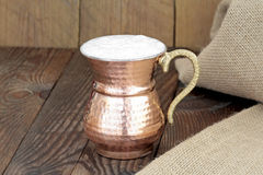Ayran - Traditional Turkish yoghurt drink in a copper metal cup Royalty Free Stock Photos