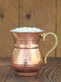 Ayran - Traditional Turkish yoghurt drink in a copper metal cup Stock Image