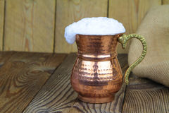 Ayran - Traditional Turkish yoghurt drink in a copper metal cup Royalty Free Stock Photo