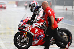 Ayrton Badovini #86 på Ducati Panigale 1199 R Team Ducati Alstare Superbike WSBK Royaltyfri Foto