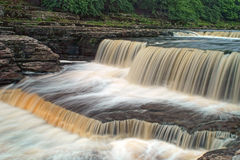 Aysgarth Falls - Waterfall. Aysgarth Falls is on the the River Ure in Wensleydale, North Yorkshire, England. This image shows the part known as the Lower Falls Royalty Free Stock Photos