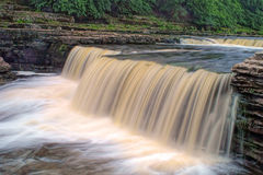 Aysgarth Falls - Waterfall. Aysgarth Falls is on the the River Ure in Wensleydale, North Yorkshire, England. This image shows the part known as the Lower Falls Stock Photos
