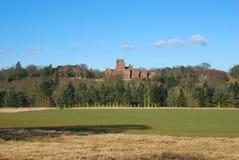 Ayton Castle from south, Berwickshire. Ayton castle from south over fields and woods in Berwickshire Stock Photos
