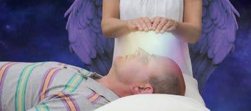 Ayuda angelical durante una sesión curativa Foto de archivo libre de regalías