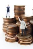 Ayuda con las materias del dinero imagen de archivo libre de regalías