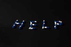 AYUDA de la palabra hecha de píldoras Imágenes de archivo libres de regalías