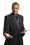 Ayuda de ofrecimiento del hombre de negocios con las manos abiertas. Foto de archivo