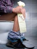 Ayuda del WC Foto de archivo