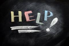 Ayuda escrita con tiza Imagen de archivo libre de regalías