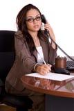 Ayudante administrativo en el teléfono fotos de archivo