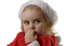 Ayudante astuto de Santa que muerde sus clavos Foto de archivo libre de regalías