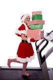 Ayudante de Santas en la rueda de ardilla con los regalos Imagen de archivo