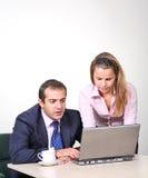 Ayudante del hombre de negocios y de la hembra imagenes de archivo