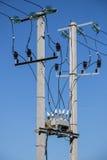 Ayudas de la línea eléctrica Aisladores, caja de conexiones Foto de archivo libre de regalías