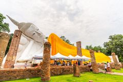 Reclining buddha statue in Thailand. AYUDDHAYA, THAILAND - CIRCA DATE, 2015 : Big white reclining sleeping lord buddha statue in ruined church without roof in Royalty Free Stock Photos