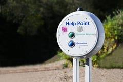 Ayude al centro de llamada de la inducción del lazo del punto para la ayuda del servicio de emergencia en la estación de tren púb imagenes de archivo