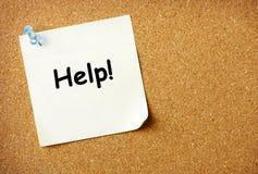 Ayude a la nota sobre tarjeta de aviso fotos de archivo