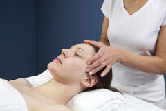 Ayurveda forehead and temple massage Stock Photography