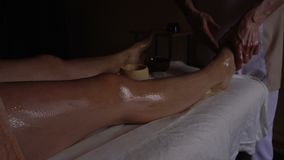 Ayurveda Massage concept. Beautiful young woman reciving relxing Massage from Professional Masseur, with Spices on her