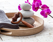 Ayurveda and mindfulness for calming body massage over balancing stones Royalty Free Stock Images
