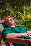 Ayurveda-treatment. Man has a rest after an ayurveda-application, on his head a herbal pack Royalty Free Stock Image