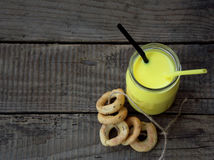 Ayurvedic healthy golden drink with coconut milk and ghee for beauty and health. Selective focus. Stock Photo