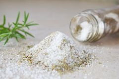 Ayurvedic herbal Salt in glass jar. Sea salt with aromatic herb - rosemary, oregano, sage, marjoram, basil, thyme, mint, bay leaf royalty free stock photo
