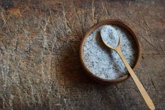Ayurvedic herbal salt in wooden spoon. Sea salt with aromatic herb - rosemary, oregano, sage, marjoram, basil, thyme, mint, bay le. Ayurvedic herbal salt in stock image