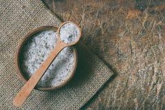 Ayurvedic herbal salt in wooden spoon. Sea salt with aromatic herb - rosemary, oregano, sage, marjoram, basil, thyme, mint, bay le. Ayurvedic herbal salt in royalty free stock photos
