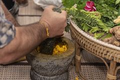 Ayurvedic medicine, the manufacture of herbal bags royalty free stock photography