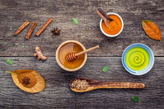 Ayurvedic medicine and nature spa ingredients honey ,herbal comp. Ress ball,turmeric,cinnamon powder ,cinnamon sticks ,aromatic oil ,thyme ,peppermint and star Royalty Free Stock Images