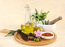 Ayurvedic Oil in Glass Bottle or Herbal Hair Oil with Herbs royalty free stock images