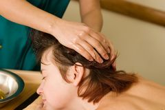 Ayurvedic oil massage of the scalp Royalty Free Stock Images